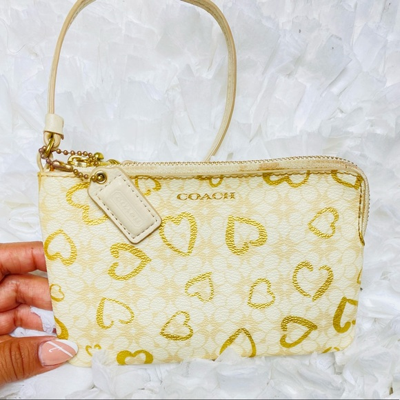 Authentic wristlet Coach color cream and gold
